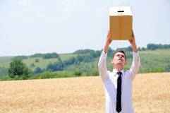 Business Man delivering box Royalty Free Stock Photos