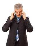 Business man in depression. With hand on forehead, isolated over white Royalty Free Stock Image