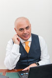 A business man at desk, deep in thought. Stock Photography