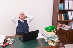 Business man at desk, deep in thought. Royalty Free Stock Images