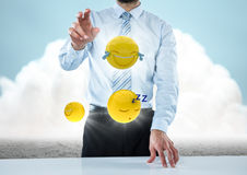 Business man at desk with emojis and flares against ground and cloud. Digital composite of Business man at desk with emojis and flares against ground and cloud Stock Photography