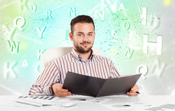 Business man at desk with green word cloud Royalty Free Stock Photo