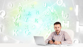 Business man at desk with green word cloud Royalty Free Stock Images