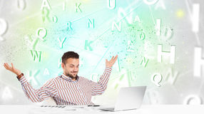 Business man at desk with green word cloud Stock Image