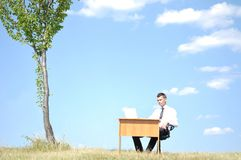 Business man at desk outside Royalty Free Stock Photos