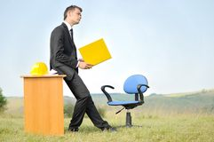 Business man at desk outside Stock Photo
