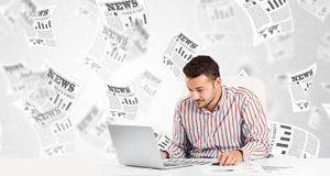 Business man at desk with stock market newspapers Stock Images