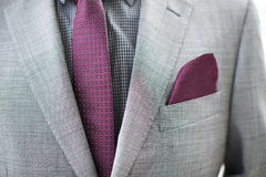 Business Man details of grey jacket and tie. Business man details of a grey jacket and wine-red tie and handkerchief Royalty Free Stock Photo