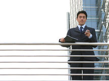 Business man dialling on mobile Royalty Free Stock Photos