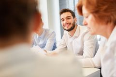 Business man in dialogue with team. Business men in dialogue with team planning in cooperation stock image