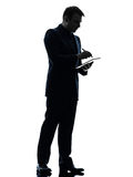 Business man  digital pen stylus tablet  silhouette Royalty Free Stock Image