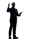 Business man digital tablet  silhouette Stock Photos