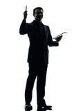 Business man digital tablet  silhouette Stock Photos