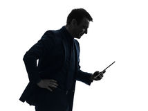 Business man  digital tablet smiling  silhouette Stock Image