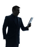 Business man  digital tablet surisped shocked silhouette Stock Photo