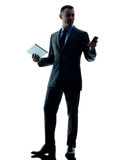 Business man digital tablet  telephone isolated Royalty Free Stock Photography