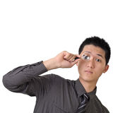 Business man discover. Concept by holding magnifier on one eye Stock Photos