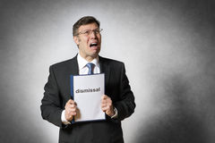 Business man with dismissal. Crying business man with german dismissal Royalty Free Stock Images