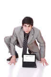 Business man displaying a laptop Royalty Free Stock Photography