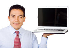 Business man displaying laptop Stock Images