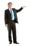 Business man displaying something Stock Images