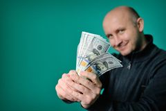 Business Man Displaying a Spread of Cash Royalty Free Stock Photos