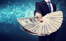 Business Man Displaying Spread of Cash. Business Man Displaying Spread of one hundred dollar bills Stock Photos