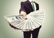 Business Man Displaying a Spread of Cash Stock Photography