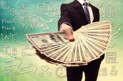 Business Man Displaying a Spread of Cash Stock Images
