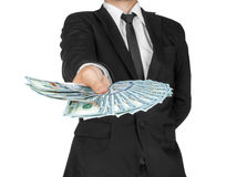 Business Man Displaying a Spread of Cash over Stock Photo