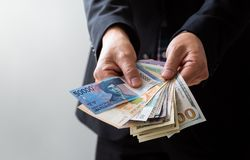 Business Man Displaying a Spread of Cash Stock Image