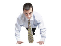 Business man do push up. Isolated business man doing push ups royalty free stock image