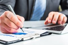 Close-up of Businesswoman makes a note at business royalty free stock photo