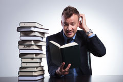 Business man doesn't understand book Stock Photo