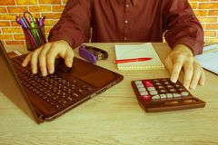 Business man doing finances on calculate analysis working with financial results Financial accounting sales forecast graph. Businessman Calculating Invoices Royalty Free Stock Image