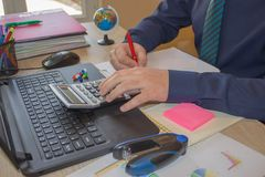 Business man doing finances on calculate analysis working with financial results Financial accounting sales forecast graph. Businessman working in his laptop Stock Image