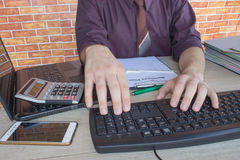 Business man doing finances on calculate analysis working with financial results Financial accounting sales forecast graph. Man Ca. Business man doing finances Stock Photography