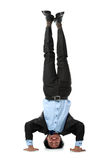 Business man doing handstand Stock Photos
