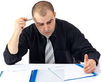 Business man doing hard work at office Royalty Free Stock Photo