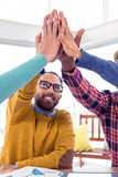 Business man doing high five with team in creative office stock image