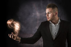 Business Man With Dollars on Fire Royalty Free Stock Photography