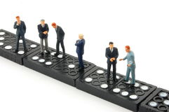 Business man on domino Royalty Free Stock Image