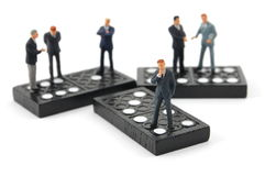 Business man on domino Stock Image