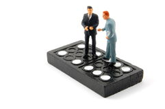 Business man on domino isolated Stock Images
