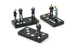 Business man on domino isolated Stock Photos