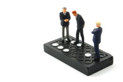 Business man on domino isolated Royalty Free Stock Photography