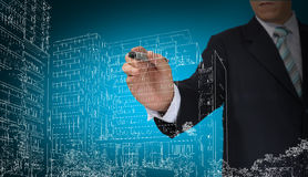 Business Man draw building and cityscape Royalty Free Stock Photo