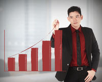 Business man draw increasing chart. With office background Stock Photo