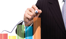 Business man drawing chart bar. / Economy and Finance concept Royalty Free Stock Photo