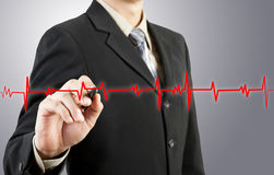 Business man drawing chart heartbeat. For any use stock images